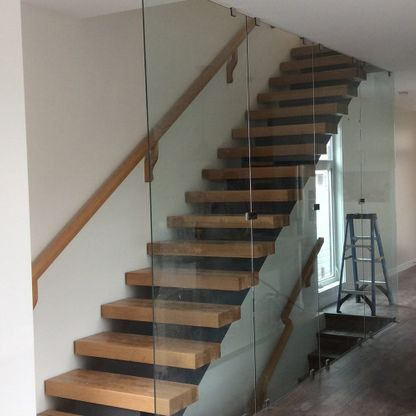 Wood and glass straight staircase