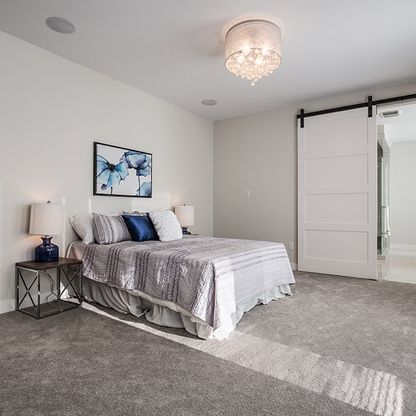 Blue/grey bedroom with white hanging barn door