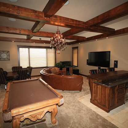 Basement family room with wood beams