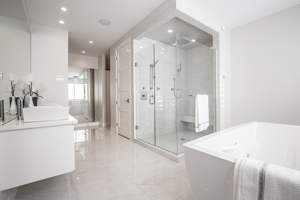 Modern white bathroom with large bathtub and shower