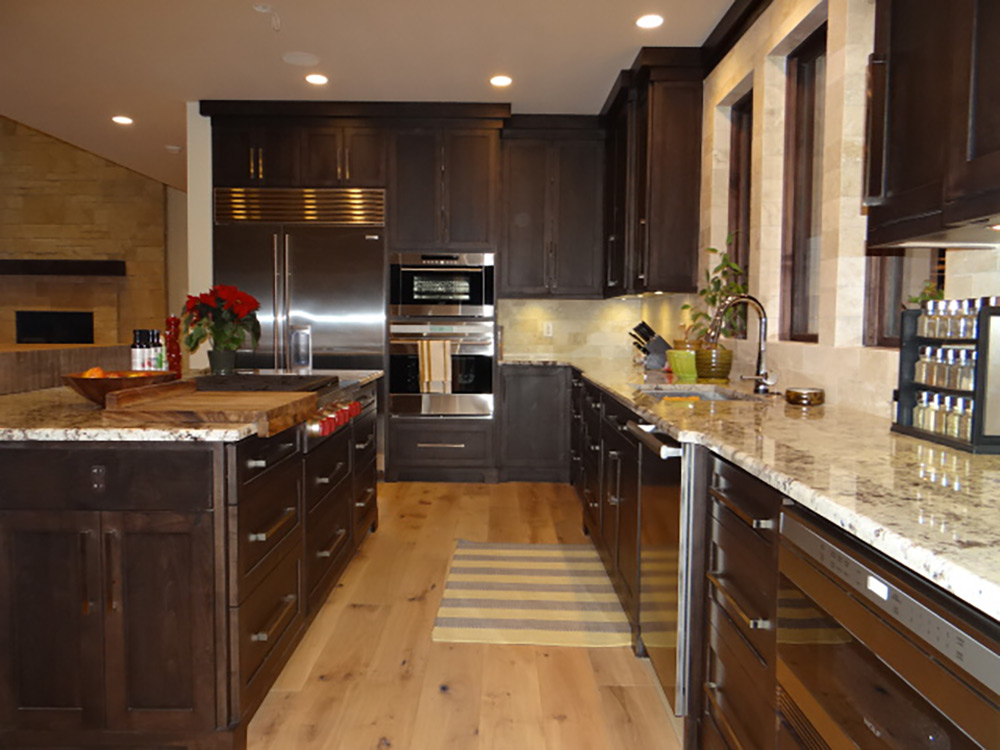 Dark wood kitchen and marble countertop