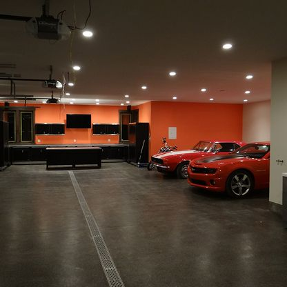 Garage with two red cars
