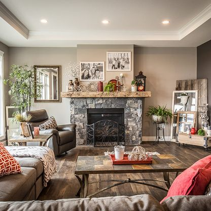 Grey living room with sectional sofa and stone fireplace