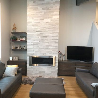Living room with white stone gas fireplace