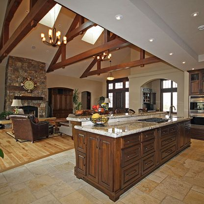 High ceiling living room/kitchen with wood beams
