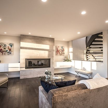 Modern living room with black spiral staircase