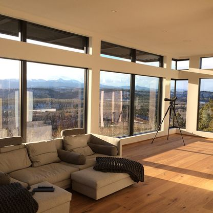 Sunny living room with telescope