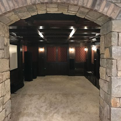Stone arch entrance to cinema room